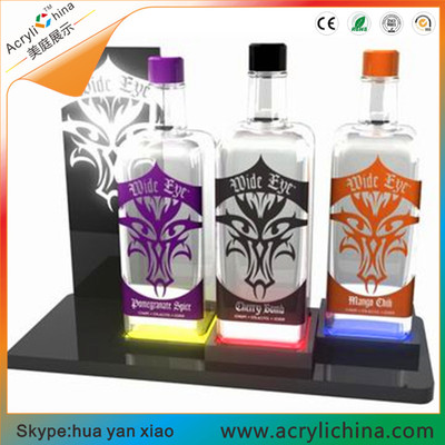 Acrylic wine bottle base holder.jpg